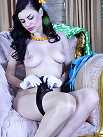 Dazzling brunette attaching her six-strap suspender to contrast top nylons