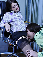 Leggy office babe in a mini skirt takes a load onto her sexy black nylons