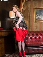 Holly is pleased to show off her rare vintage jet black nylons and her open bottom girdle.