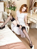 Beautiful redhead Lola is up in the bedroom trying on a vintage dress!