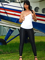 Gorgeous MILF posing in front of a plane
