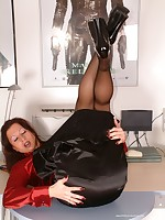 That´s unbelievable - this secretary is all buttoned up in her satin ruffle blouse, long satin skirt and black pantyhose. Who would have thougt she gets so kinky ? She lifts up her skirt and reveals a huge meaty pussy framed by the crotchless pantyhose. She lays back on her desks, pushes and flexes a bit and then gushes a huge golden shower all across the office
