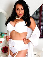 Danica ready for bed in white lingerie, stockings and suspenders