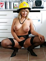British milf in stockings dressed as a fireman