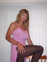 Busty British MILF in pantyhose flashes her big boobs